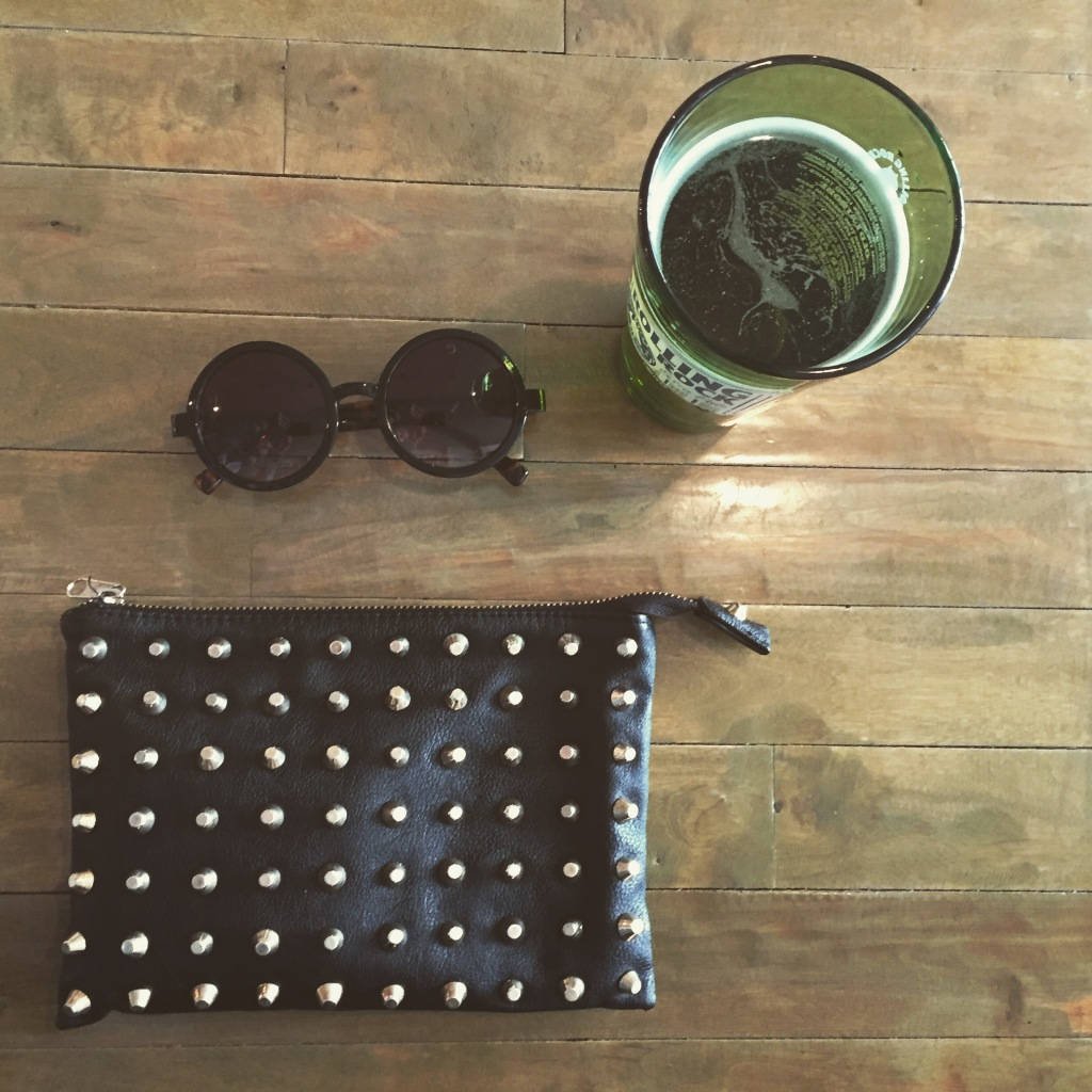 clutch and round sunglasses